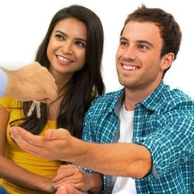 Young couple getting keys to home